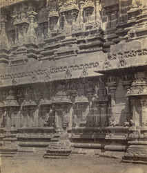 Streevelliputtur [Srivilliputtur]. Carvings on stone base of tower